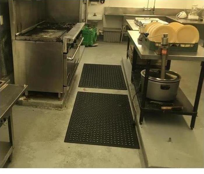 clean-looking floor and appliances in a kitchen