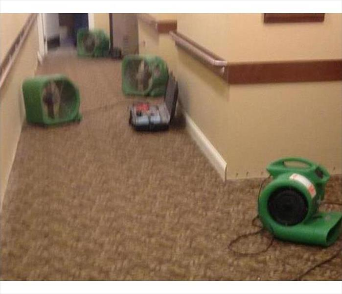 no visible water, green air movers drying out the corridor