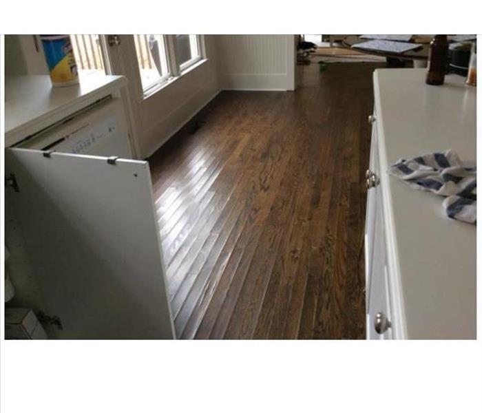 Water removed revealing cupped floorboards
