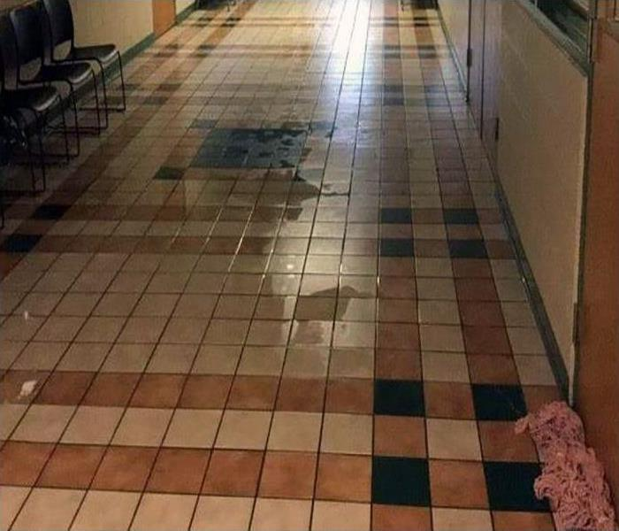 water damaged tile flooring
