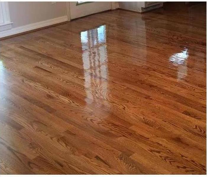 a brightly finished floor after sanding smoothed the surface