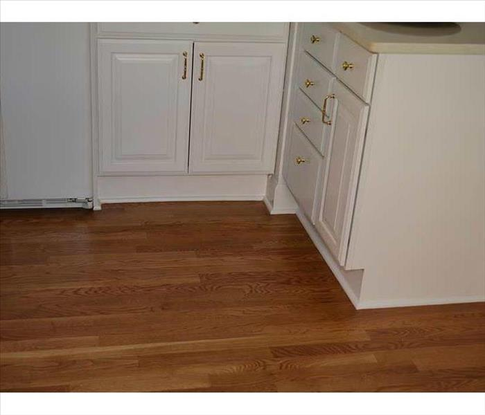 kitchen cabinets-white- and a newly installed hardwood floor