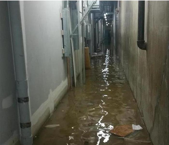 Service corridor of a commercial building flooded with about two inches of water