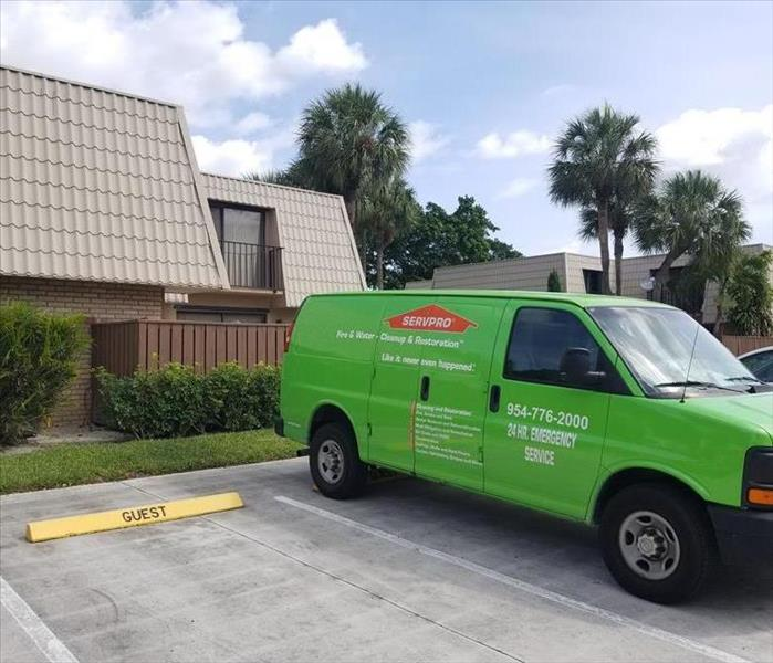 A SERVPRO vehicle parked in a parking lot.