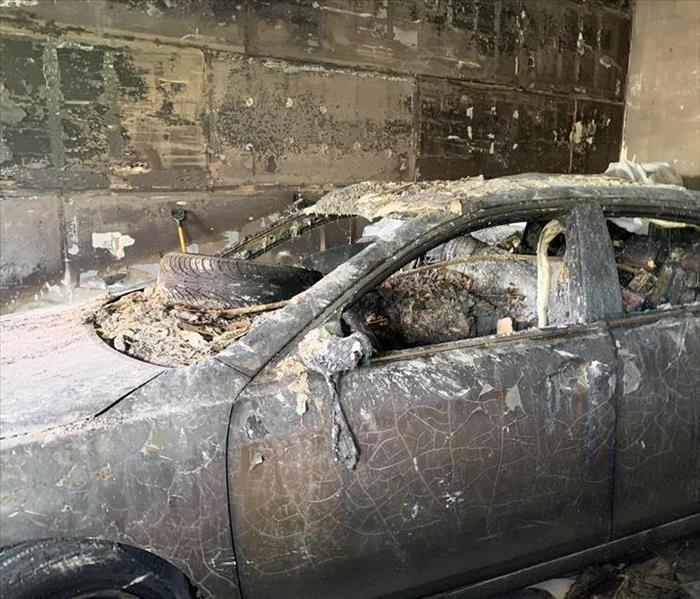 Burnt car with fire damage with soot damage.