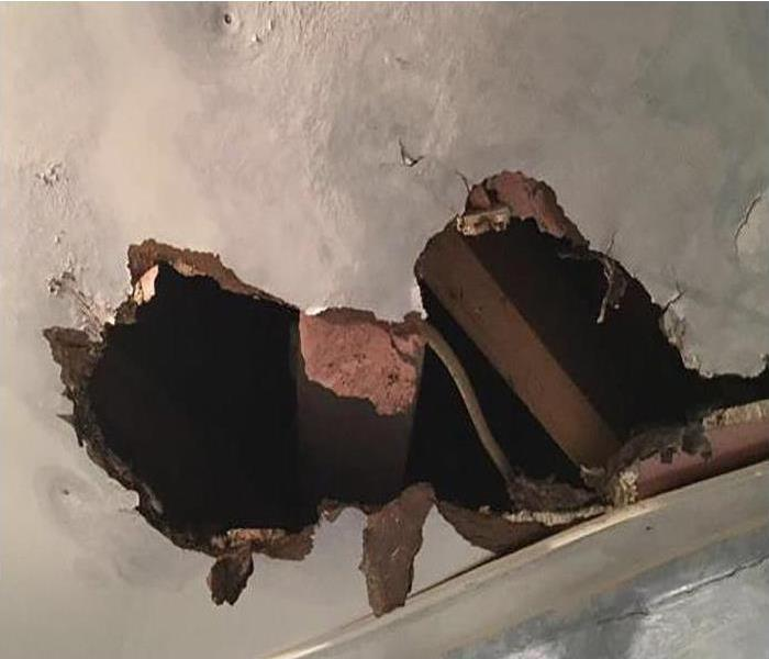 leak caused hole in ceiling
